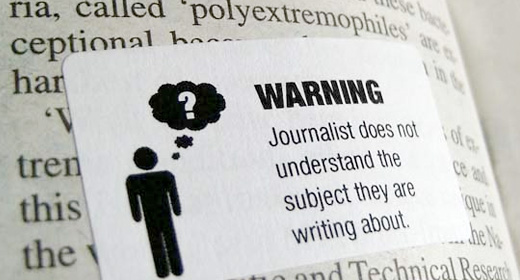 Pasting warning labels over crappy newspapers