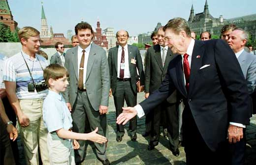 In May 1988, President Ronald Reagan was in Moscow and on a walkabout in the Red Square, he met 'tourists' which included the man with the camera around his neck standing behind the boy – Vladimir Vladimirovich Putin, a KGB agent