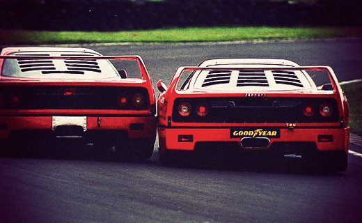 A Ferrari F40 takes on another in a race dated 5th July 1998